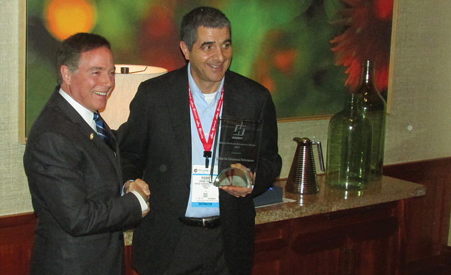 J.J. Haines CEO shakes with president of Boa-Franc