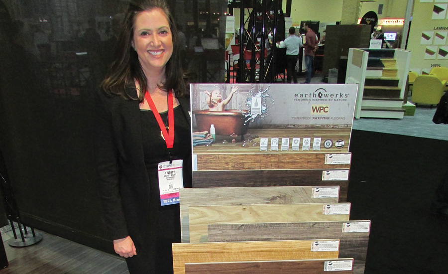 Earthwerks' Lindsey Nisbet with WPC flooring