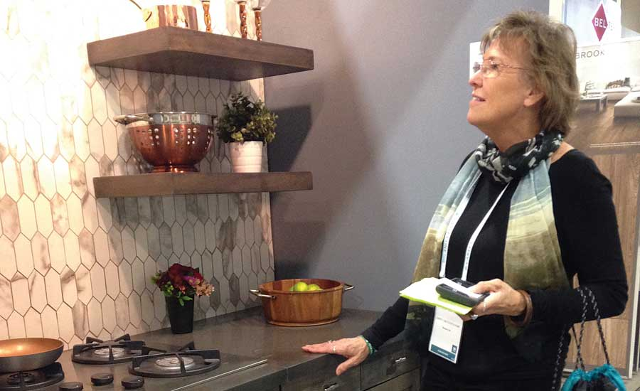 Sheila Clayton perusing products on the show floor