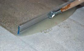 applying moisture barrier over concrete